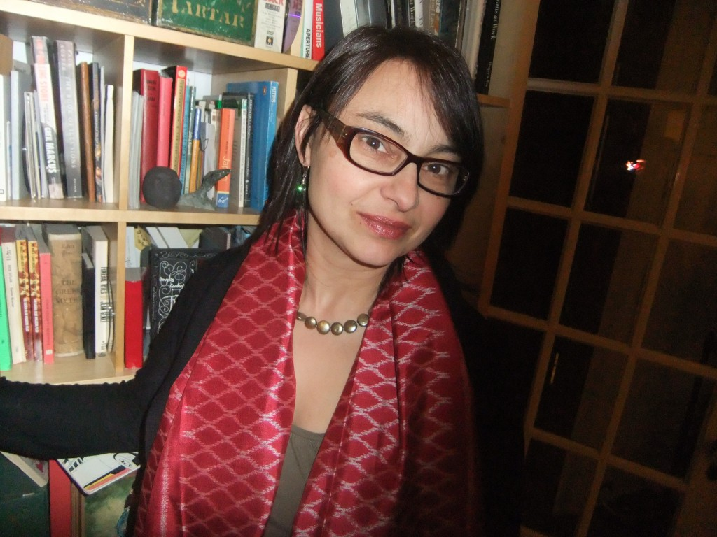 Meg by bookshelf looking left