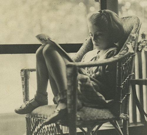 A young Joan Mitchell reading. Courtesy of the Joan Mitchell Foundation.