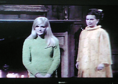 Mannix colors: Carolyn (Nancy Barrett) and Mrs. Stoddard (Joan Bennett) frozen in the drawing room of the Great House at Collinwood.  Have both of them forgotten their lines?