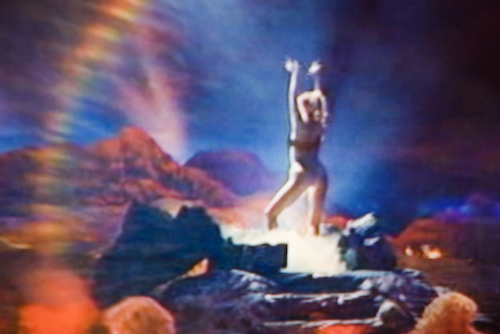 """Success at last: Nomi erupts from the Vegas volcano.  Photograph by Frank Mullaney: """"Rainbow"""" (2009)."""