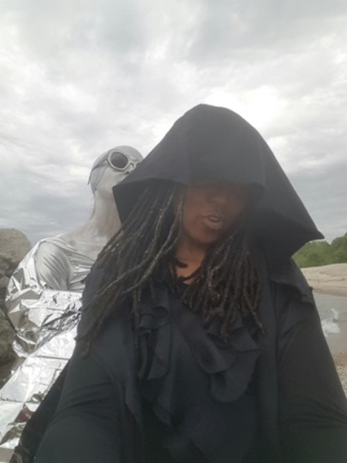 Foreground Duriel E. Harris as Jack/Death, background Lisa Samuels as EULA (End User Licensing Agreement). (photograph provided by author)]